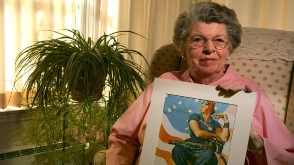 Courant File Photo of Mary Doyle Keefe, posing with the Norman Rockwell Painting she modeled for